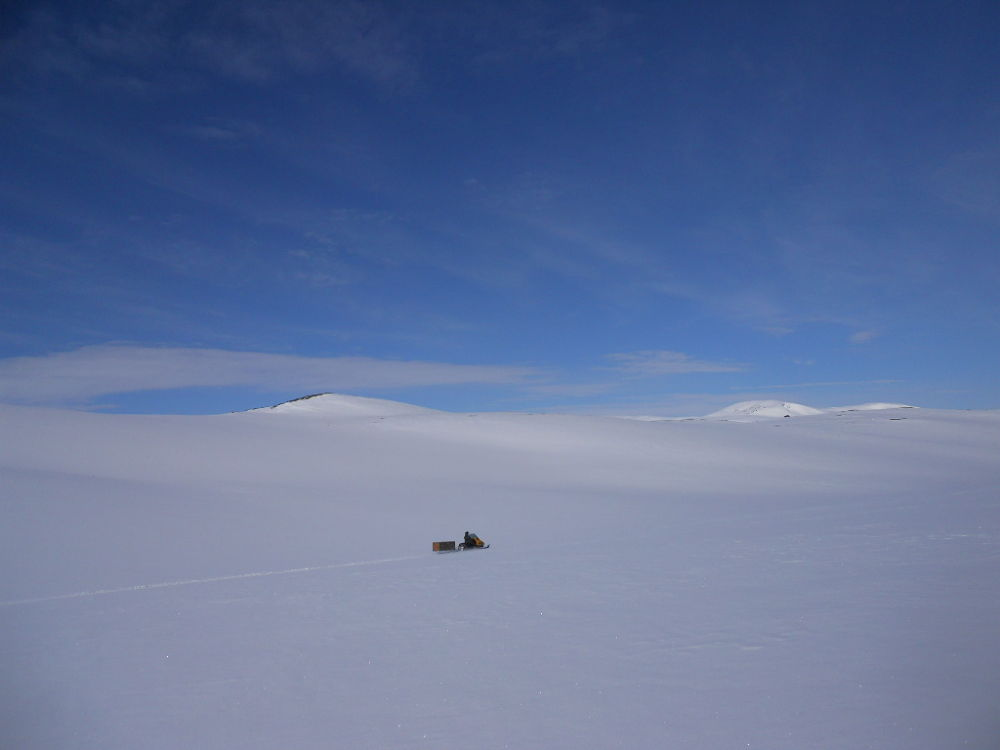 in the mountain with snowmobiles by Vivian Pedersen