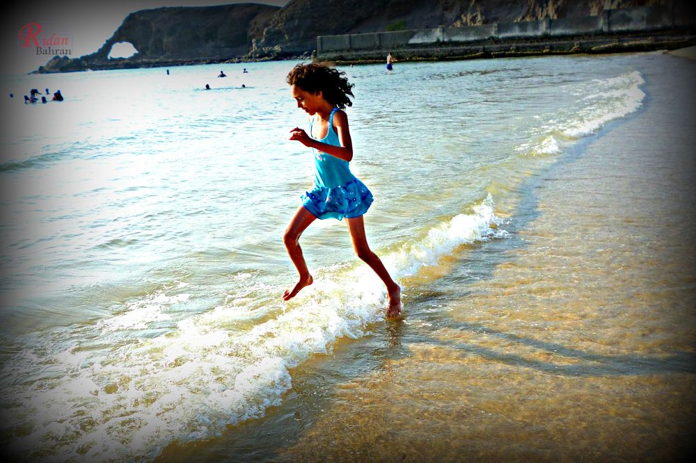 Photo in Sea and Sand #surg #coast #beach #child #jump #aden #yemen #happy #rawan