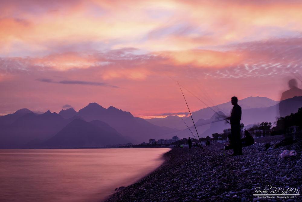 Sunset and fishermen in Antalya by Serdar Süyün