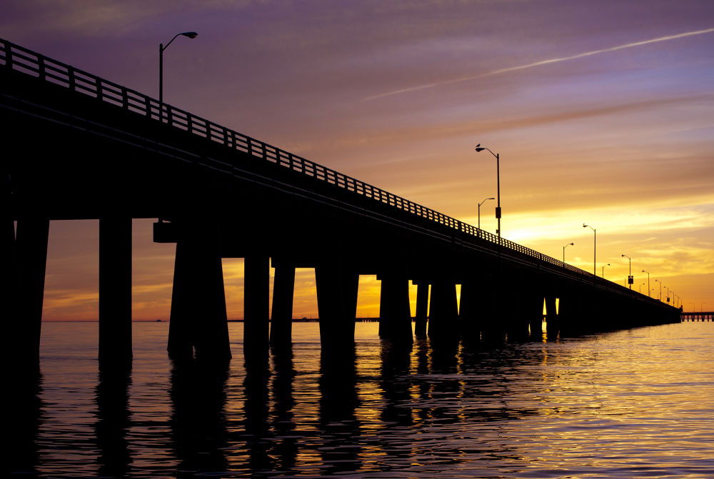 Photo in Architecture #sunset #bridge #ocean