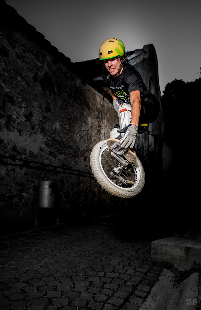 Photo in Sports #unicycle #jump #man #city