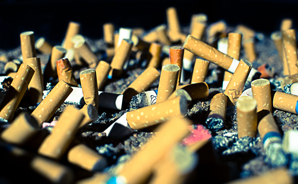 Cigarette Cemetery  by Marc Crowther