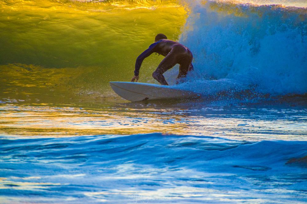 Rainbow Surfer by Jason Kirkpatrick