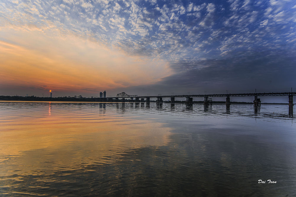 Sunset with Long Bien Bridge by Dai Tran