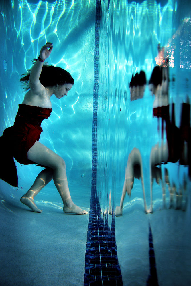 Photo in Fine Art #underwater #reflection #red dress #unusual places #beautiful #mirror #flowing hair #model