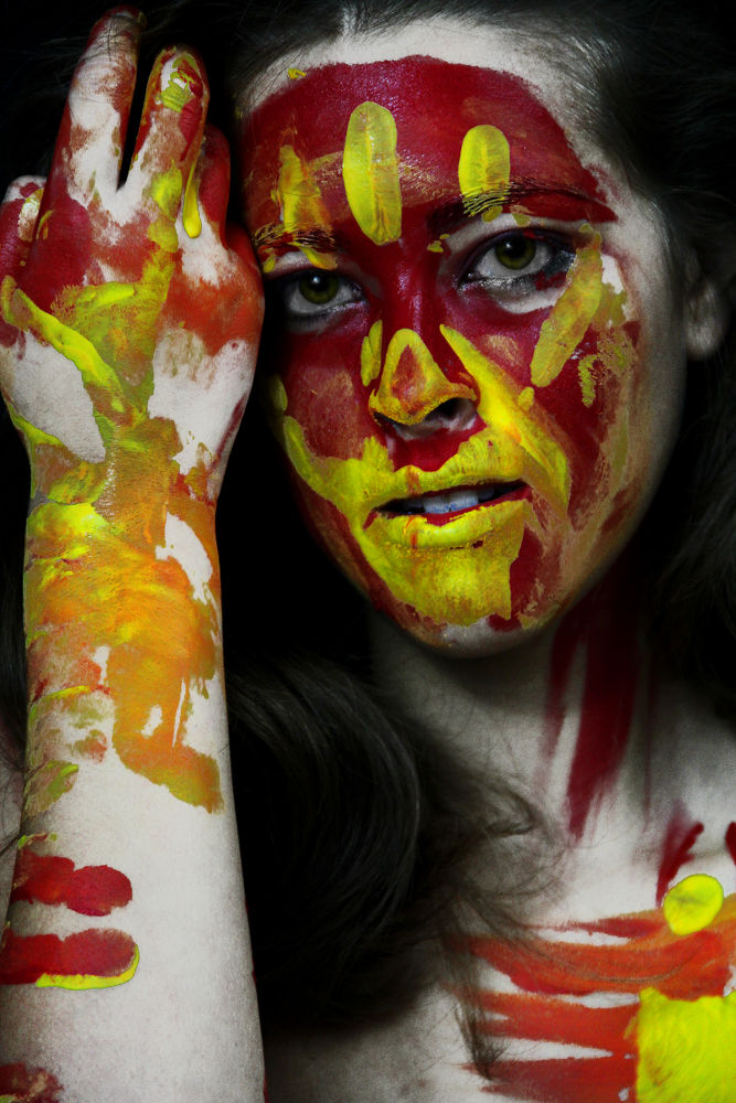 Photo in Portrait #woman #paint #yellow #eyes #model #red #green eyes #color selection #portrait #handprint #facepaint