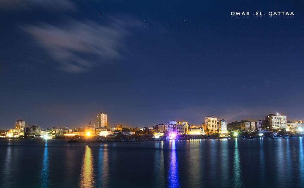 Port of Gaza at night  by Omar El Qattaa