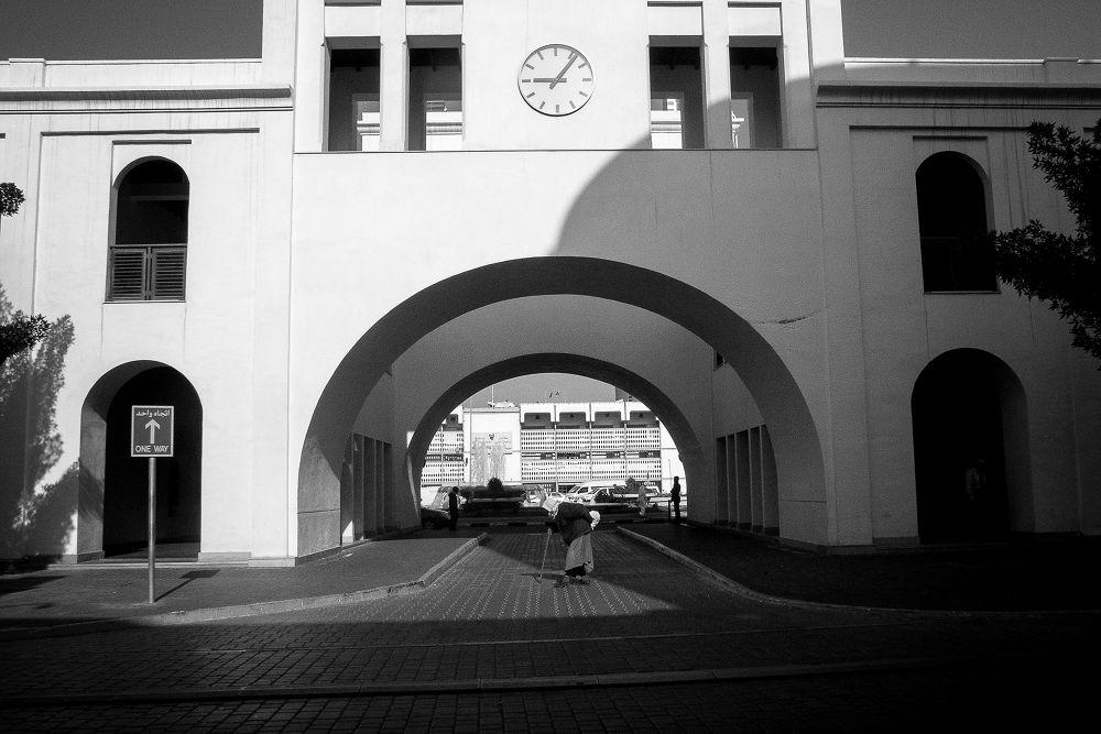 Photo in Street Photography #streetphotography #blackandwhite #wacky_tom #michael ryan borja #old man #one way #walking #people #arc #street life #black and white #monochrome