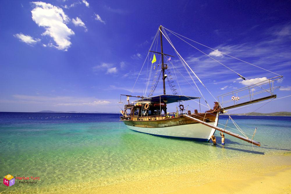 Photo in Travel #boat #sea #sand #sky