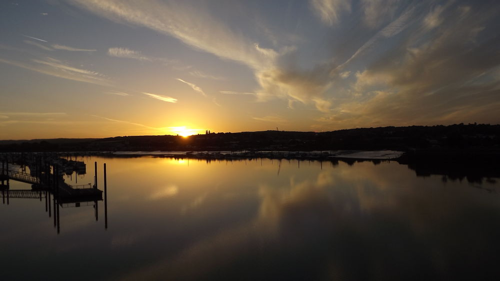 17 oct sun setting over strood. by boatystevegraphics