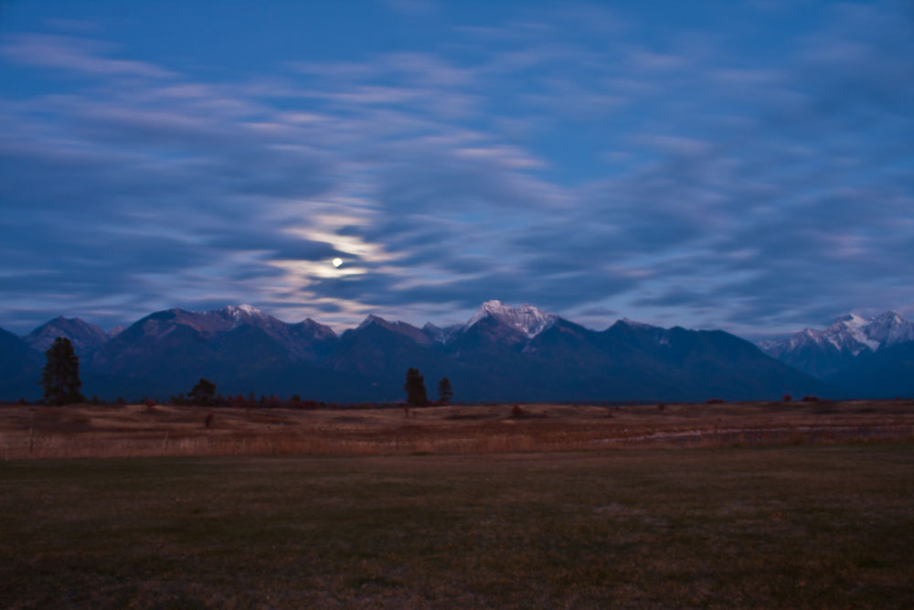 Photo in Landscape #montana #mountains #moon #clouds #landscape