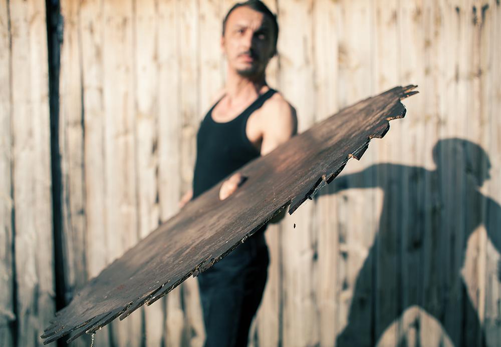 man with chainsaw by Amir Bajrich