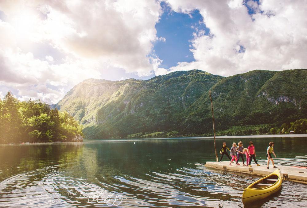 Photo in Landscape #portraitofjoy #lake #bohinj #slovenia #children play #childhood