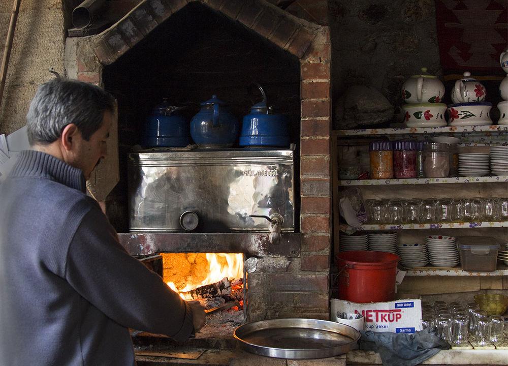 tea and coffee on wood fire by Cihan Kızıltan