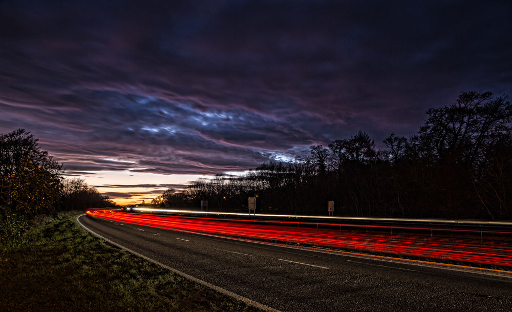 Sunset and Trails by Daniel Rose