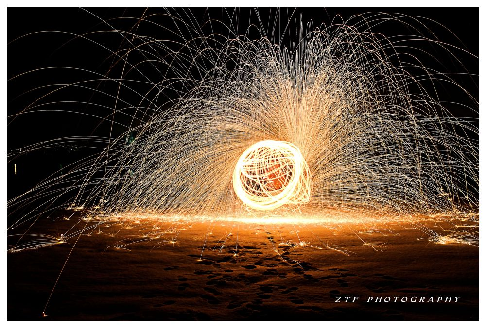 sparks on the snow by ZTF PHOTOGRAPHY