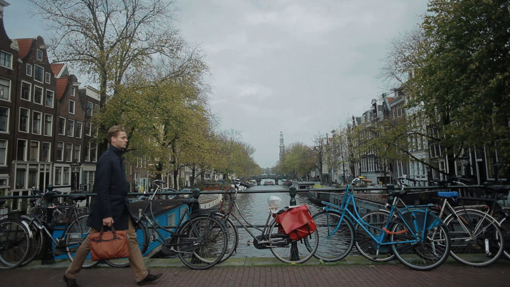 Amsterdam, man going to work by johnhope