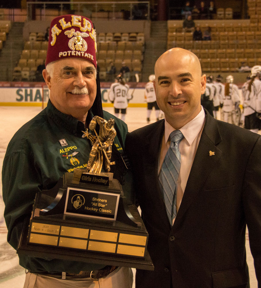 The Potentate with the All Star Classics trophy and the man in charge of the DCU Center by Seth Hunter