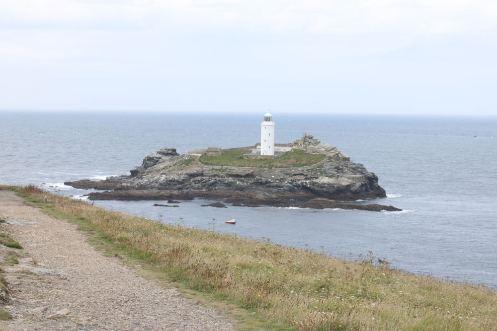 distance shot of goodreavy lighthouse cornwall by michelle