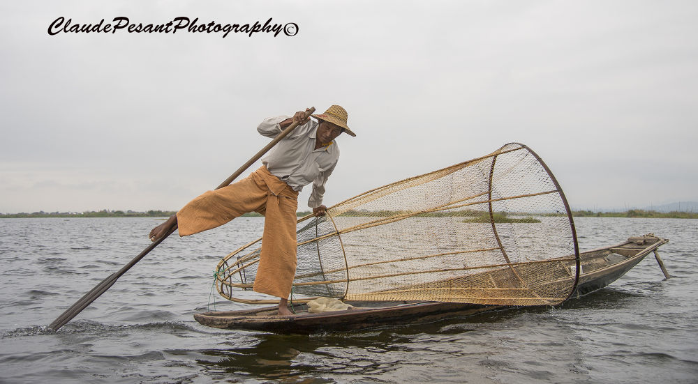 One leg rower, Myanmar by Claude Pesant