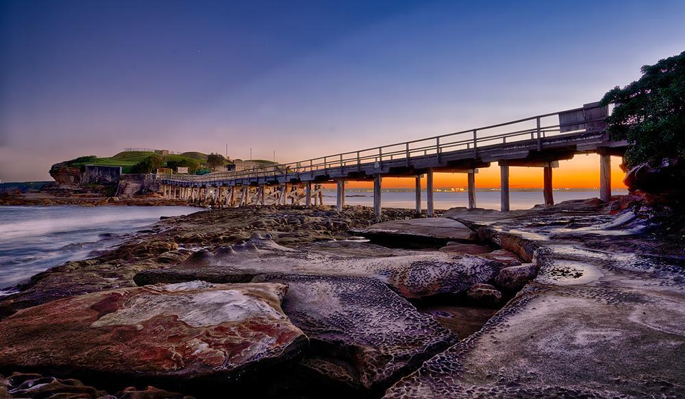 Photo in Sea and Sand #island #sunset #bridge #dusk