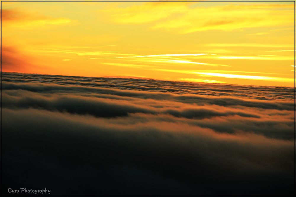Sunrise view on top of Clouds by guruprasadkr