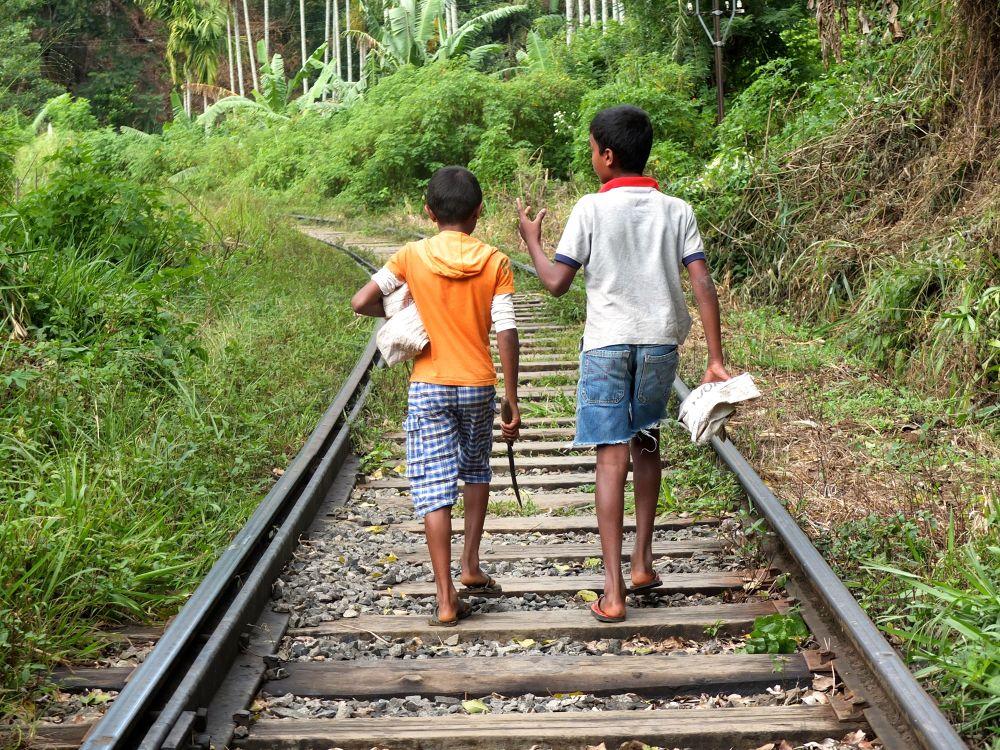 Boys along a railway by PumpkinDream