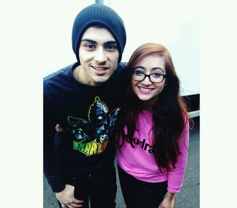 Met this beautiful fan who waited outside for 24 hours her phone died so I told her I got her back☺ by Zayn Malik