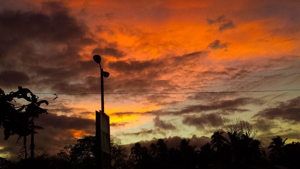 Deepening Shadows/Fiery Sky by Erlinda Bocar Kantor