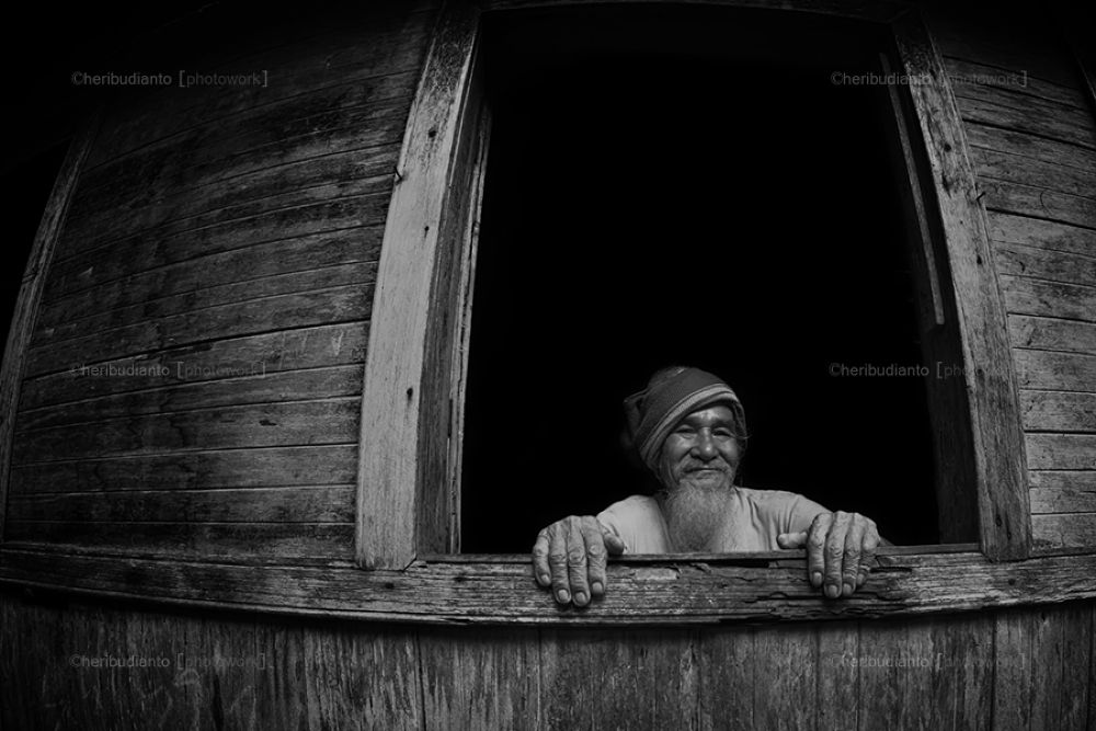 old man on window by heribudianto