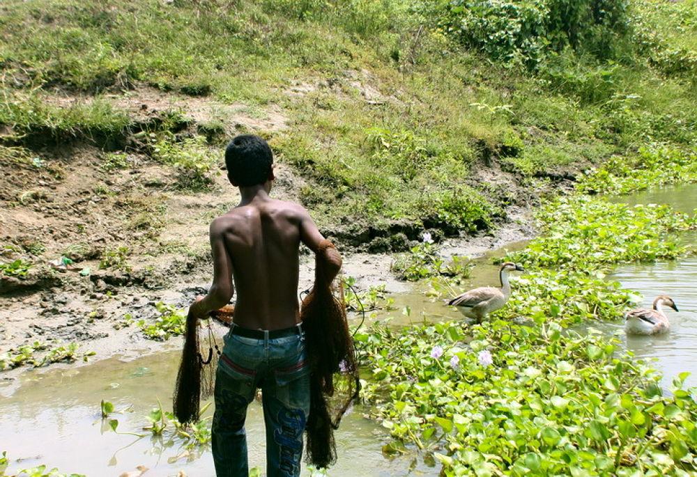 A BOY WITH FISHING NET IN HAND.JPG by ShyamalKBanik