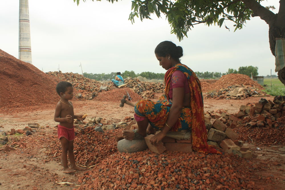 POOR WOMAN'S LABOUR FOR SURVIVING.JPG by ShyamalKBanik