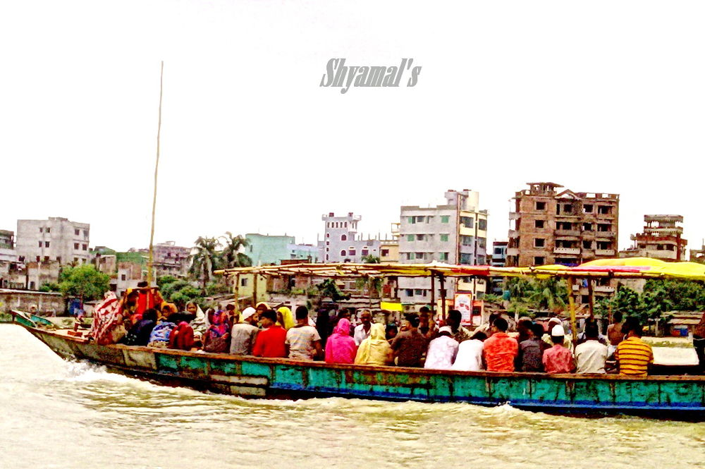 COUNTRY BOAT CARRYING PASSENGERS WITH FARE by ShyamalKBanik