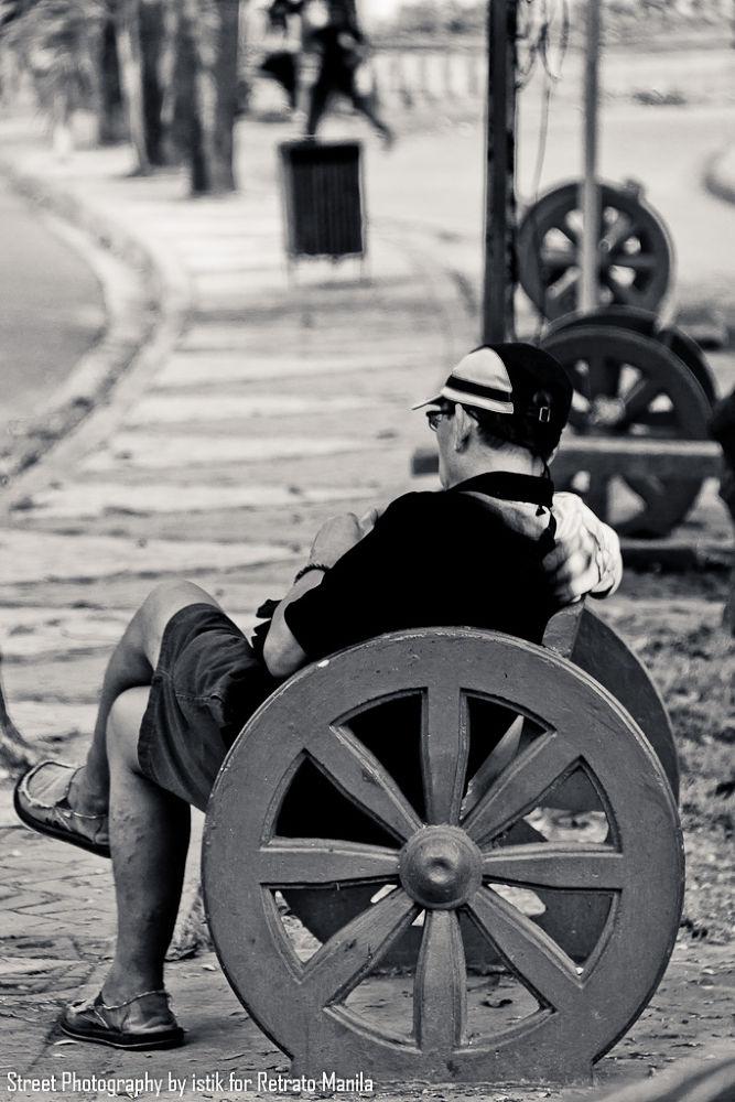 Alone in the park by retratomanila