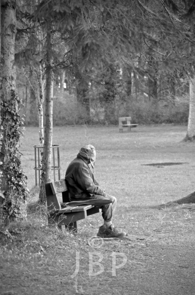 man on bench by Joe Butler