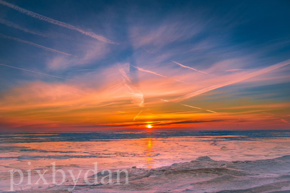 Sunrise over the frozen waters of Lake Michigan by Daniel Wade