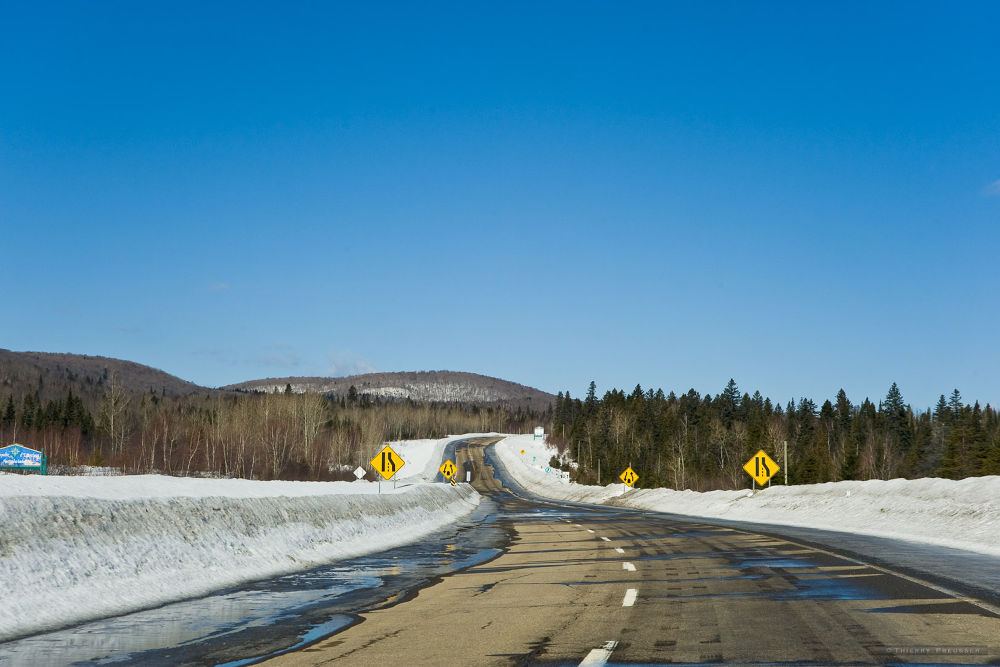 Road through the wilderness of Canada by Thierry Preusser