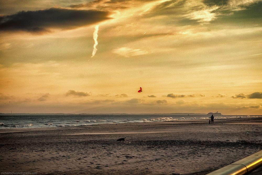Kite Flying at Dusk - Father, son and dog cast against a surreal sky by michaelschorphotography