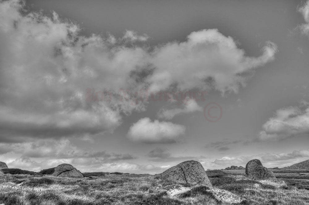 Boulders and clouds by robphot