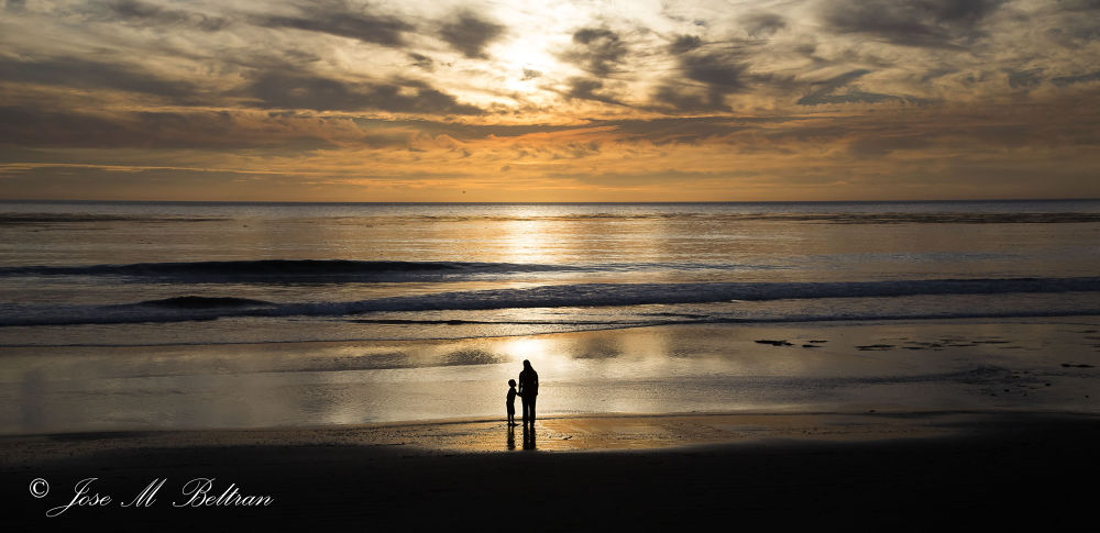 Showing the sunset to your son by Jose M Beltran
