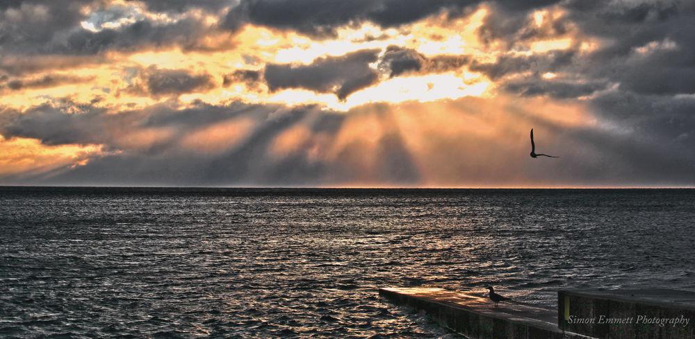 Sunrise across the bay by Simon Emmett Photography