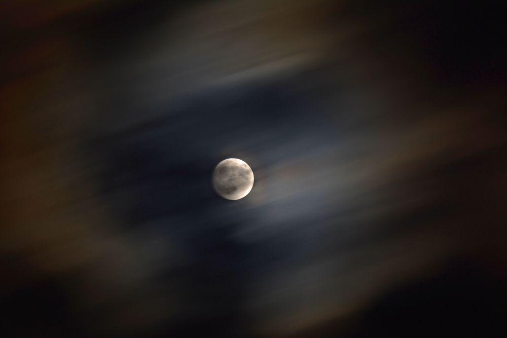 Moon on clouds by Jozef Kozlok