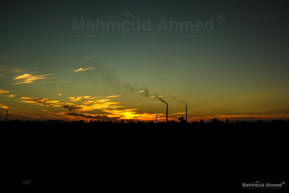 Sunset and factories Beni Suef by Mahmoud Ahmed
