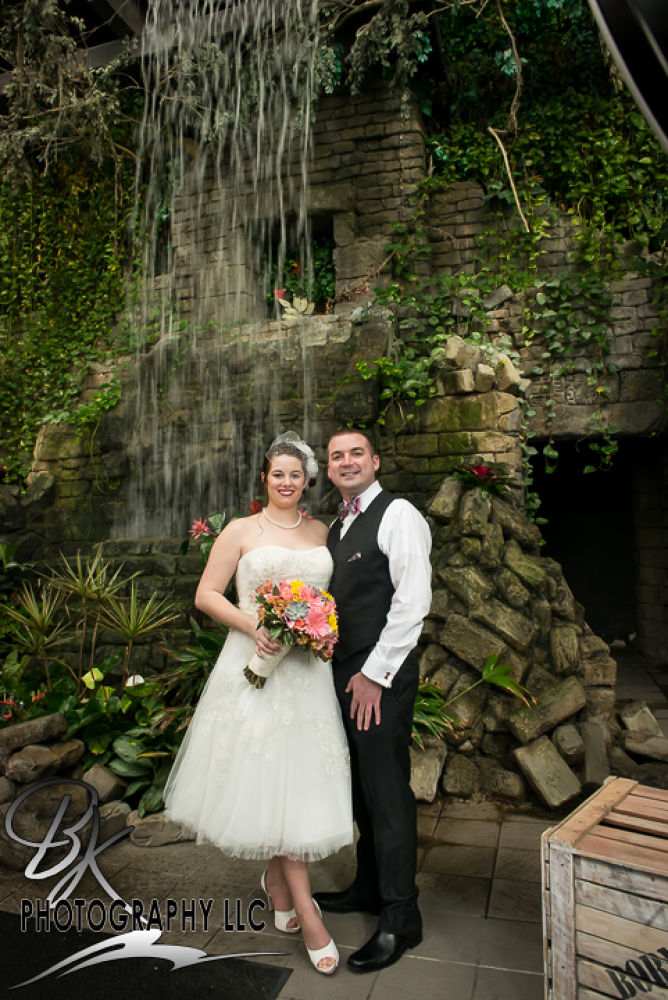 Bride and Groom in front of the waterfall by Bill Klingbeil