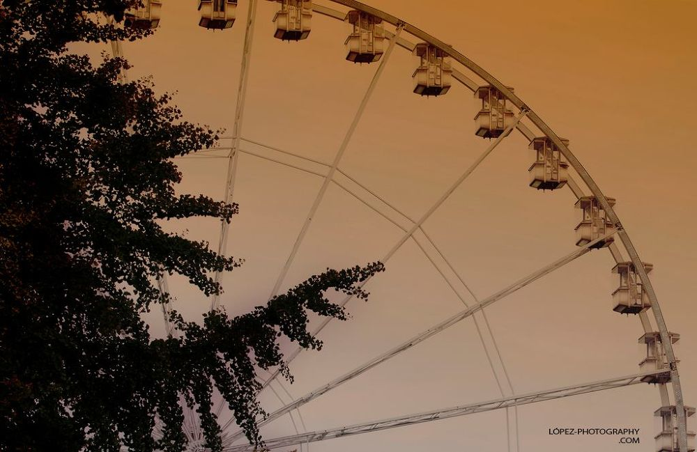 Ferris Wheel at sunset  by Jose Lopez
