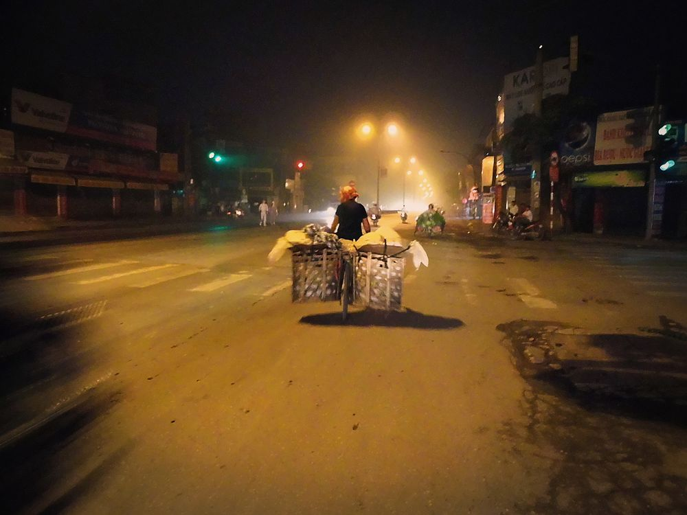 Hanoi  . 4 a.m. Going to the market by marcosarli