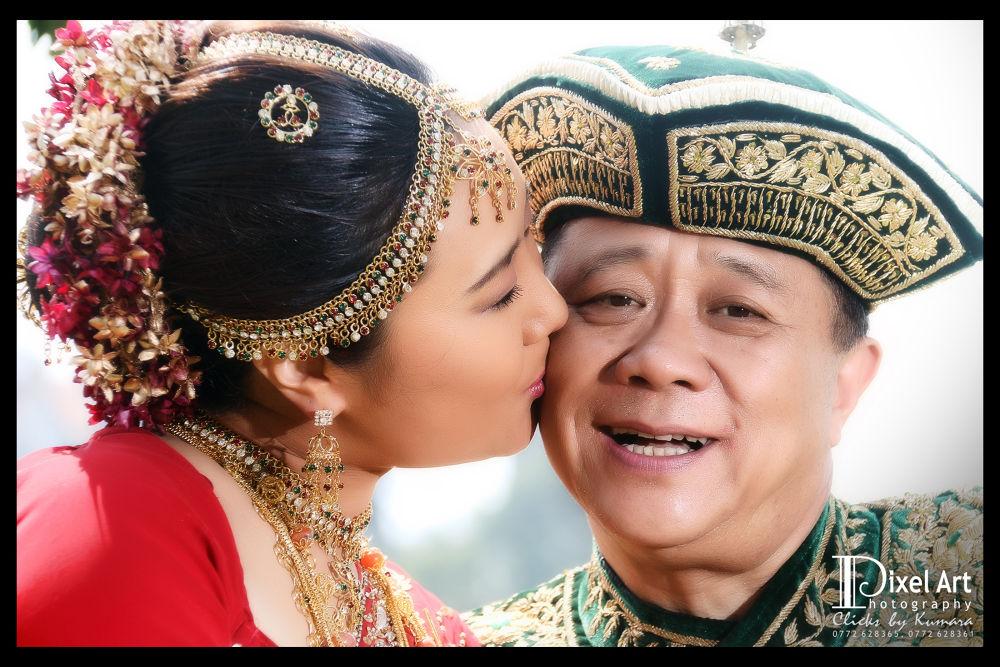 Kandian Wedding Couple by Pushpa Kumara