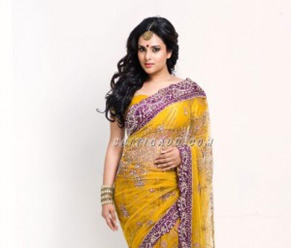 Ramya-hot-in-Yellow-Saree-stills-2-300x256 by Dipankar