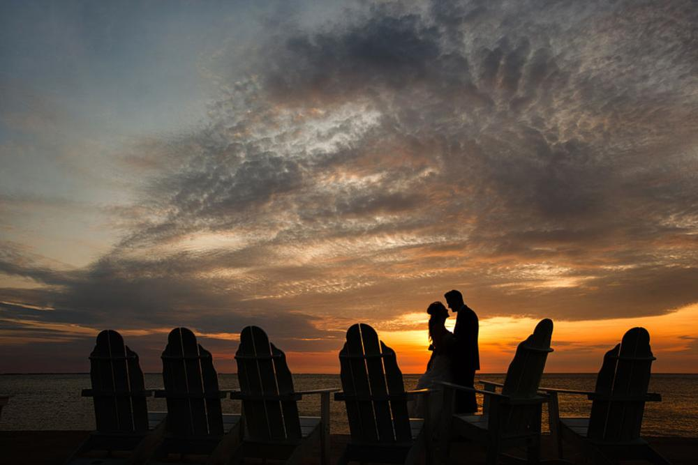 Photo in Wedding #wedding #bride and groom #beach wedding #nighttime #dramatic #sky #creative