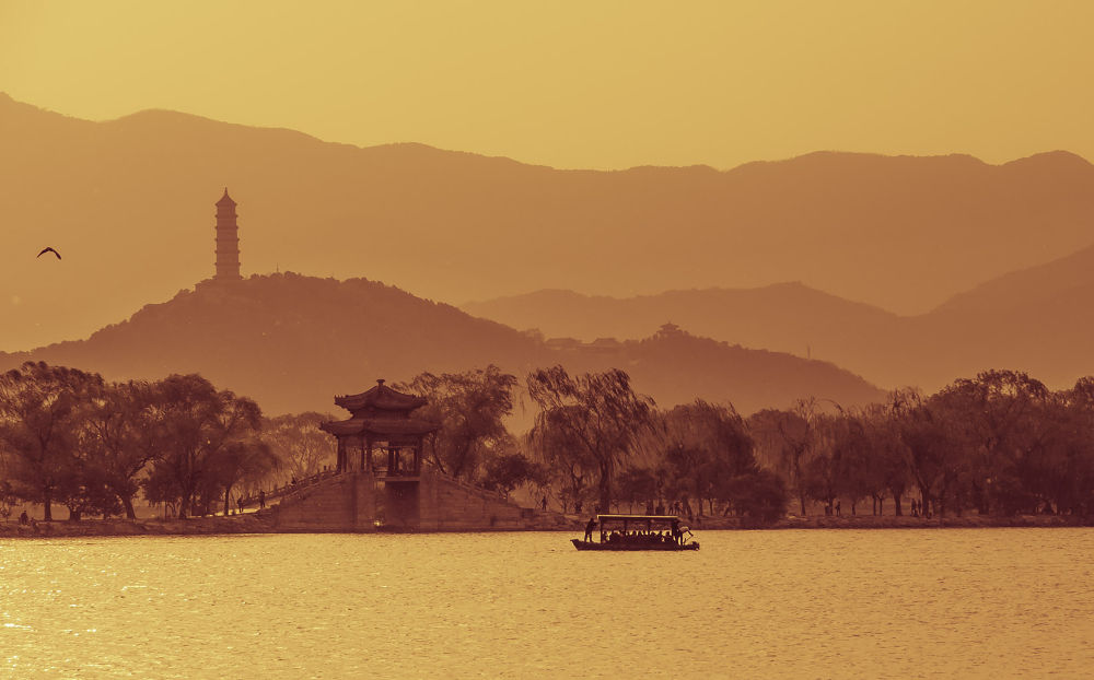 The mountains in the warm afterglow of the sunset by qianfang